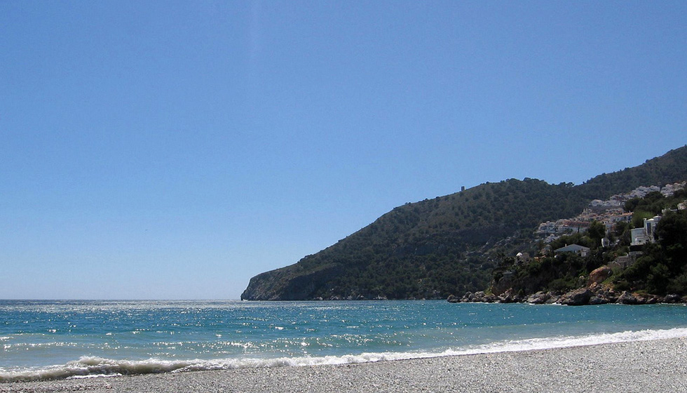 The promontory of Cerro Gordo guards the western side of La Herradura's wide  bay