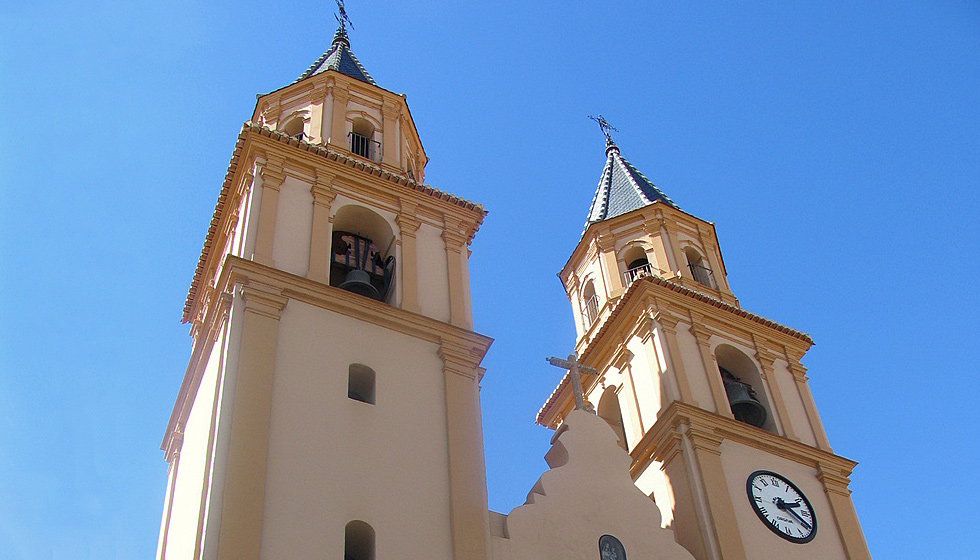 The twin towers of its 16th Century church